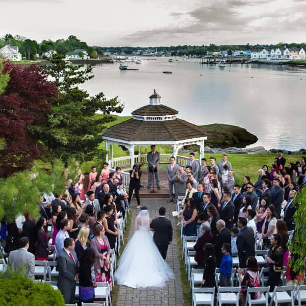 Danversport Yacht Club Asian outdoor wedding. Wedding couple photos at Christopher Columbus Park near Boston waterfront harbor